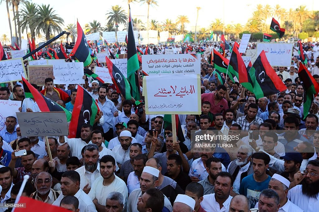 Libyans take part in a rally in support of 'Fajr Libya' mainlyIslamist alliance and to protest against the new parliament ang a military intervention...
