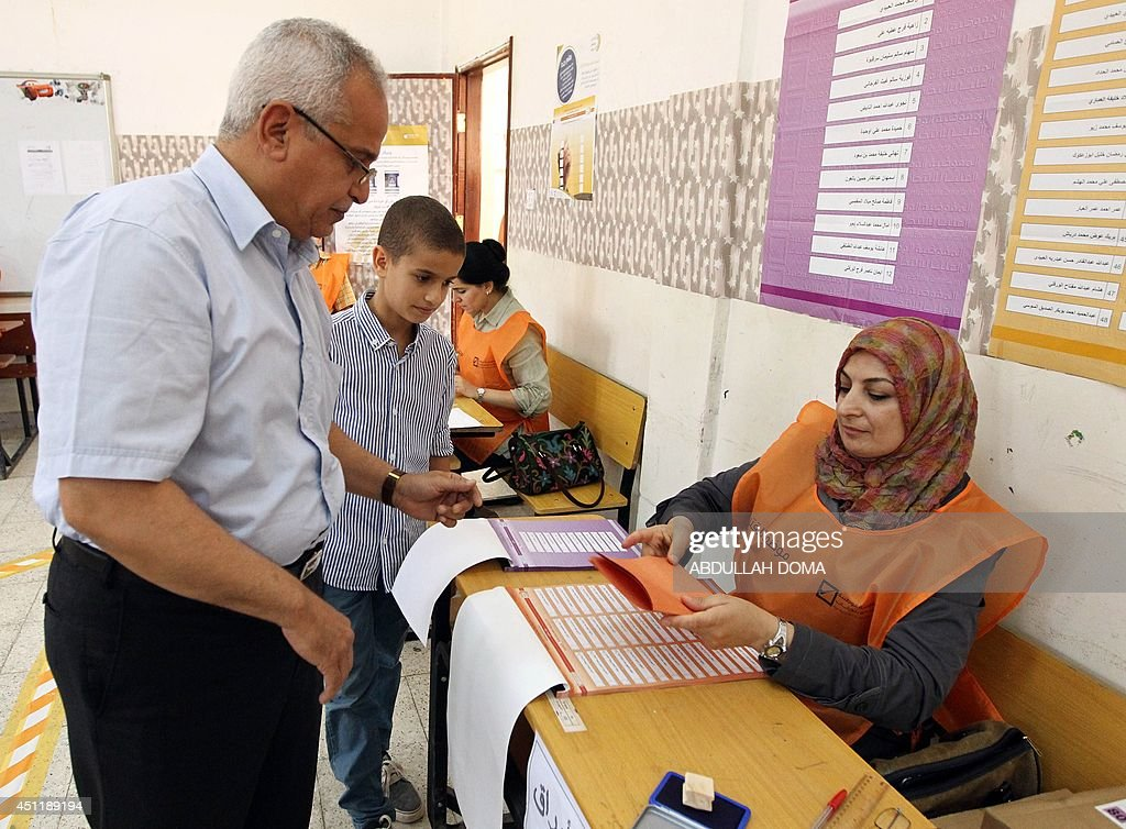 Libyans vote in legislative elections for choosing 200 members of the General National Congress or parliament at a polling station in the eastern...