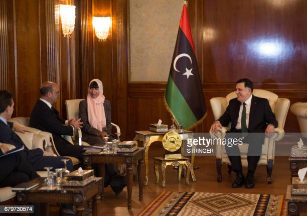 Libya's Government of National Accords 's head Fayez alSarraj meets with Italian Foreign Minister Angelino Alfano on May 6 in Tripoli Alfano held...