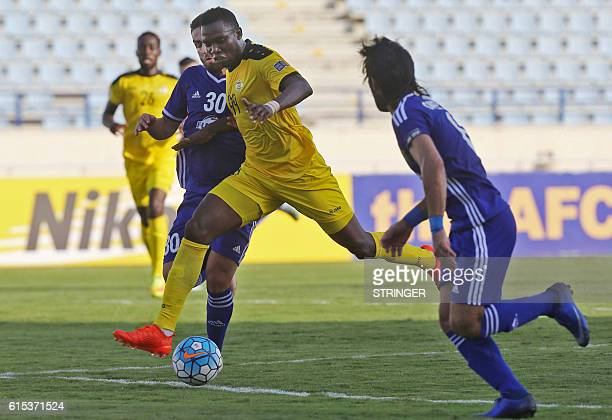 Libya's Kabiru Abdullahi Musa vies for the ball with Iraq's Hamid Mido during the 2016 Asian Football Confederation Cup semifinal second leg football...
