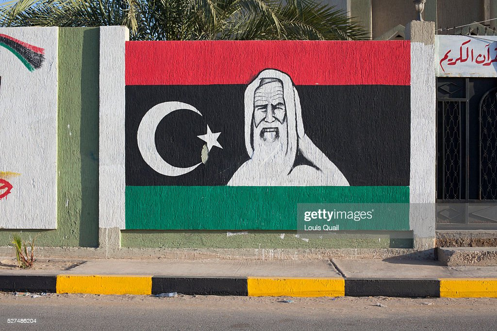 Libya's most famous freedom fighter, Omar Al-Mukhtar, is set against the Libyan flag on a wall in Tajoura. Under Gaddafi's rule, simple acts of painting anti-regime images or slogans, were dangerous. As a result, some of the artists responsible have lost their lives. Since the end of the War, graffiti has now become a significant part of Libya's visual culture, as the Libyans celebrate their freedom. After 42 years of Gadaffi's brutal dictatorship, the Libyan people have successfully fought for