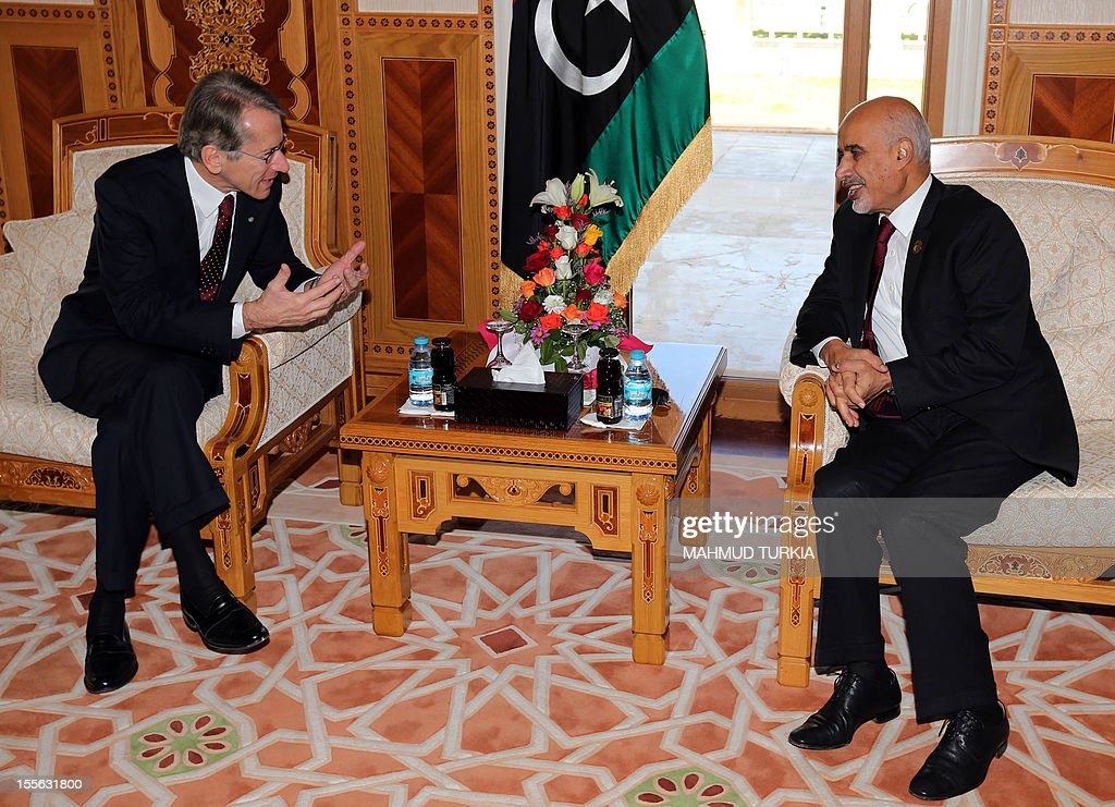 Libya's national assembly head Mohammed Megaryef (R) meets with Italian Foreign Minister Giulio Terzi (R) in Tripoli on November 6, 2012. The Italian top diplomat arrived in Libya for high level talks with the country's first elected authorities since the ouster of veteran strongman Moamer Kadhafi.