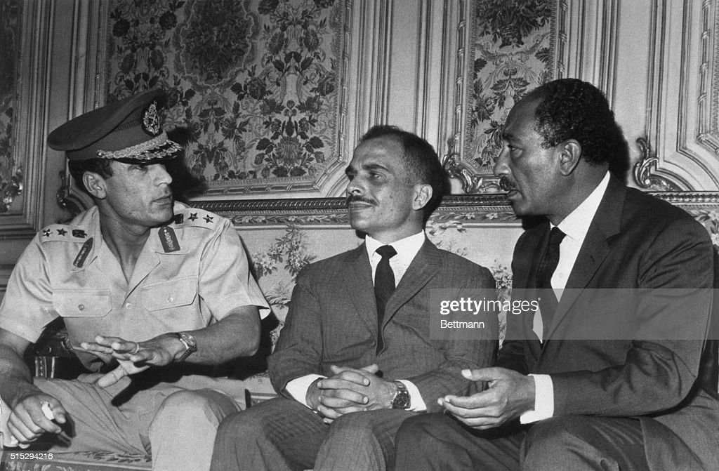 Libya's President Muammar al-Qaddafi (left) confers with Egypt's acting President Anwar Sadat (right) and Jordan's King Hussein here Sept. 30th as Egypt prepares to bury President Gamal Abdel Nasser, Oct. 1st. Soviet Premier Alexei Kosygin heads the list of foreign dignitaries who will attend the funeral.