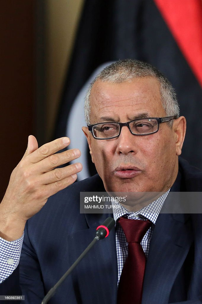 Libya's Prime Minister Ali Zeidan speaks during a joint press conference with Libyan Housing minister Ali Hassan al-Sharif and Libya's Interior Minister Ashour Shuail (not in picture) on January 30, 2013 at the Government headquarters in Tripoli, Libya.