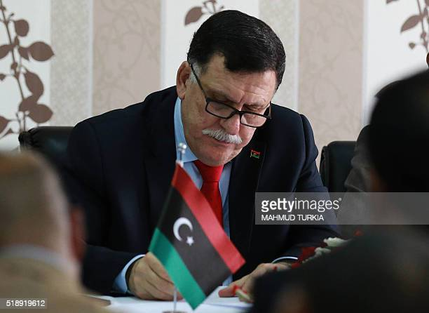 Libya's Prime ministerdesignate Fayez alSarraj chairs a Presidential Council of the Government of National Reconciliation meeting with local mayors...