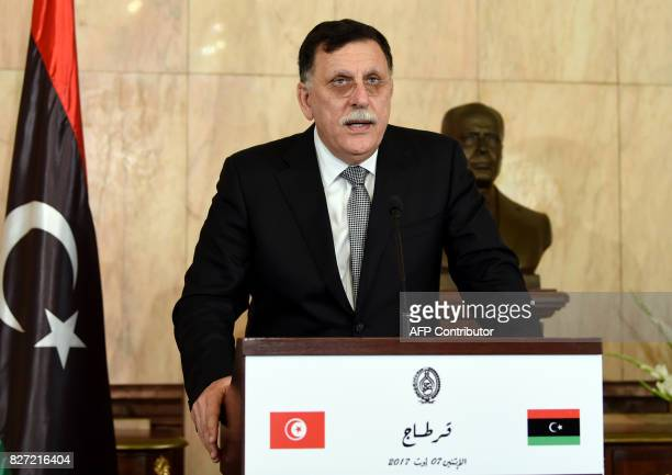 Libya's UNbacked Prime Minister Fayez alSarraj speaks to the press following his meeting with the Tunisian President in the capital Tunis on August 7...
