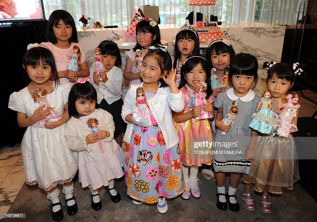 Liccachan doll fans pose during the dol Pictures Getty Images