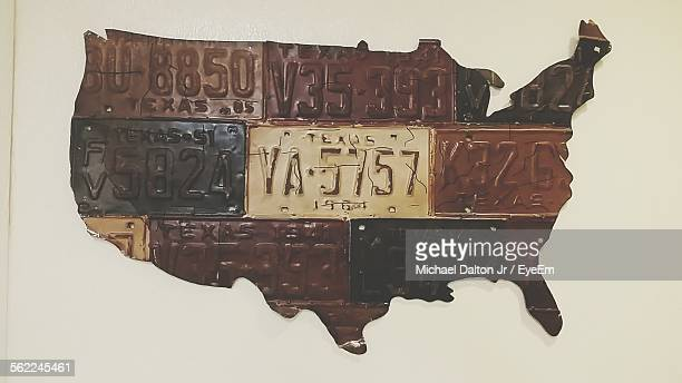 License Plates Carved In Usa Map Mounted On Wall