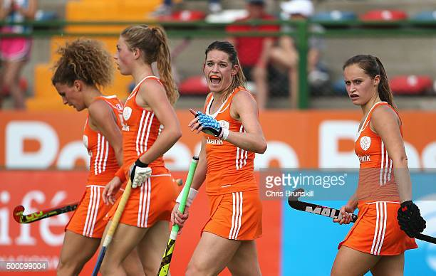 Lidewij Welten of the Netherlands celebrates scoring her teams second goal with team mates during the Hockey World League Final Pool A match between...