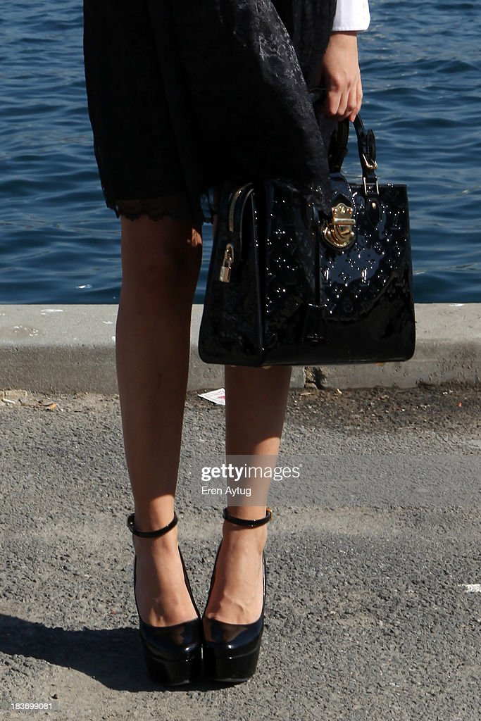 Lidiya Ostafryehuk wears a Zara shirt Mango dress Prada shoes Luis Vuitton bag and Prada glasses during MercedesBenz Fashion Week Istanbul s/s 2014...