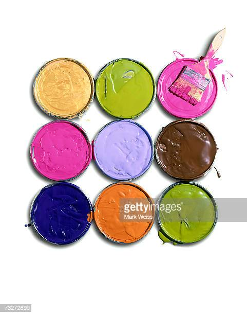 'Lids of paint cans with brush, overhead view'