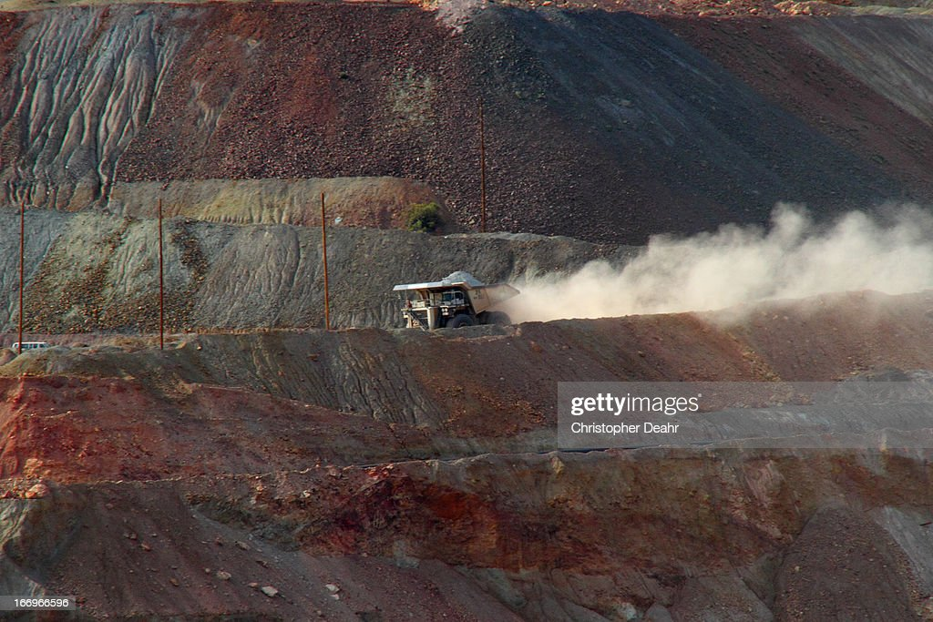 Liebherr T 232B haul truck carries a full load of nearly 400 tons of copper ore in the West Pit of the Ray Mine, near Kearny, AZ. Interesting that these mammoth trucks use 5,500 cubic inch, 3,500 horsepower diesel engines to generate electricity to turn the wheels.