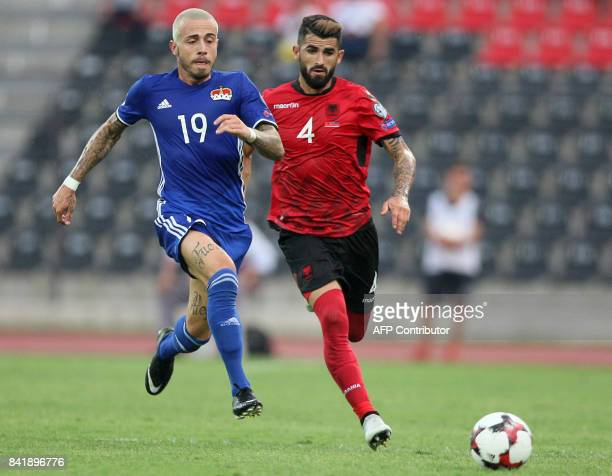 Liechtenstein's forward Dennis Salanovic fights for the ball with Albania's defender Eseid Hysaj during the FIFA World Cup 2018 qualification...