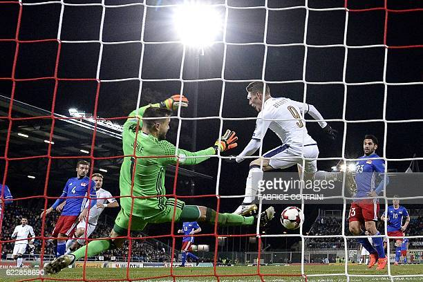 Liechtenstein's goalkeeper Peter Jehle prepares to block a shot on goal by Italy's forward Andrea Belotti during the FIFA World Cup 2018 European...