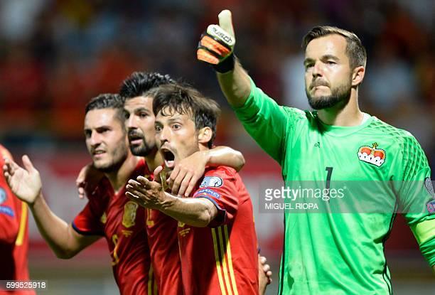 Liechtenstein's goalkeeper Peter Jehle thumbs up beside Spain's midfielder Koke forward Nolito and midfielder David Silva during the WC 2018 football...