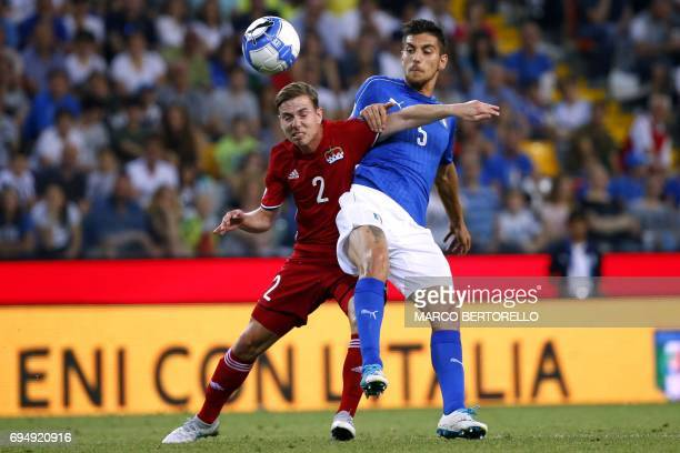 Liechtenstein's midfielder Daniel Brandle fights for the ball with Italy's midfielder Lorenzo Pellegrini during the FIFA World Cup 2018 qualification...