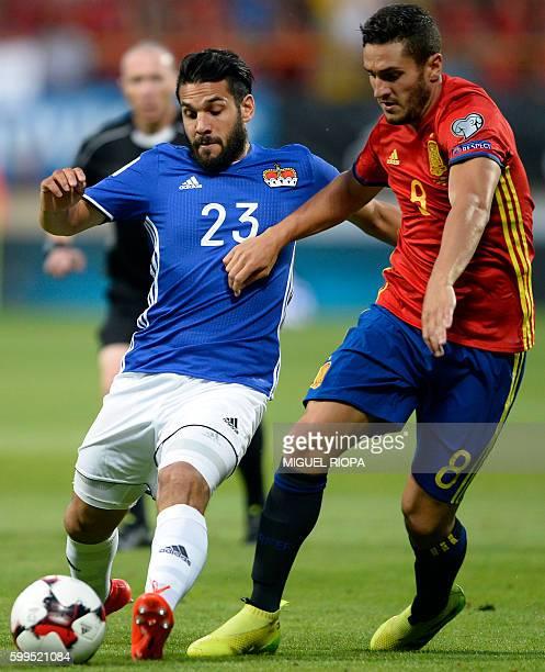 Liechtenstein's midfielder Michele Polverino vies with Spain's midfielder Koke during the WC 2018 football qualification match between Spain and...