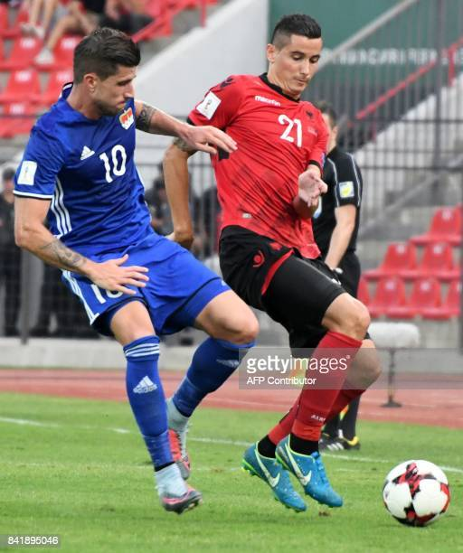 Liechtenstein's midfielder Sandro Wieser fights for the ball with Albania's midfielder Odise Roshi during the FIFA World Cup 2018 qualification...