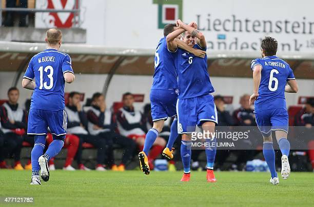 Liechtenstein's Sandro Wieser celebrate the 10 with Seyhan Yildiz and Andreas Christen during the Euro 2016 qualifying football match between...