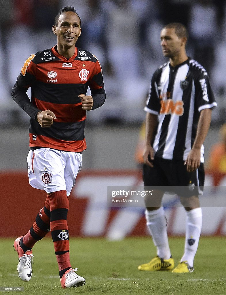 <a gi-track='captionPersonalityLinkClicked' href=/galleries/search?phrase=Liedson&family=editorial&specificpeople=674137 ng-click='$event.stopPropagation()'>Liedson</a> (C) of Flamengo celebrates a scored goal during a match between Flamengo and Atletico Mineiro as part of the Brazilian Serie A Championship, at Engenhao Stadium, on September 26, 2012 in Rio de Janeiro, Brazil.