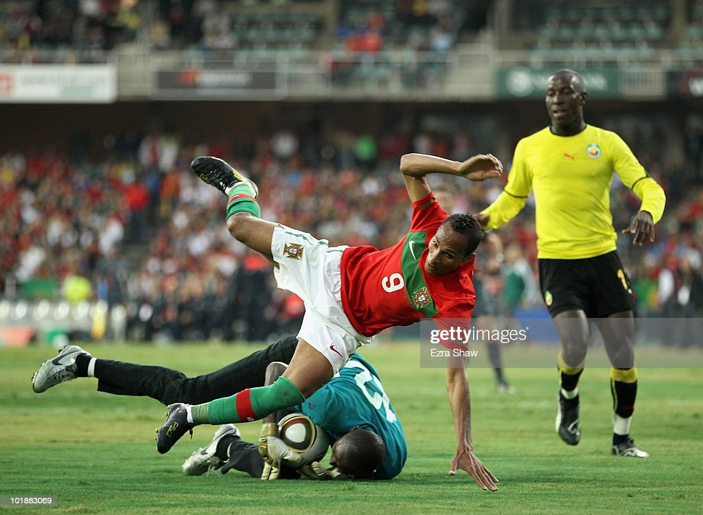<a gi-track='captionPersonalityLinkClicked' href=/galleries/search?phrase=Liedson&family=editorial&specificpeople=674137 ng-click='$event.stopPropagation()'>Liedson</a> of Portugal topples over the goalie from Mozambique during their friendly match at Wanderers Stadium on June 8, 2010 in Johannesburg, South Africa.