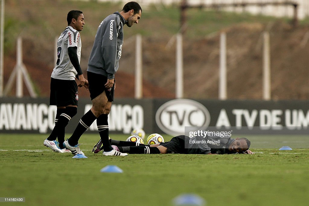 <a gi-track='captionPersonalityLinkClicked' href=/galleries/search?phrase=Liedson&family=editorial&specificpeople=674137 ng-click='$event.stopPropagation()'>Liedson</a> (R) reacts during a training session of Corinthians at Academia de Futebol on May 13, 2011 in Sao Paulo, Brazil.