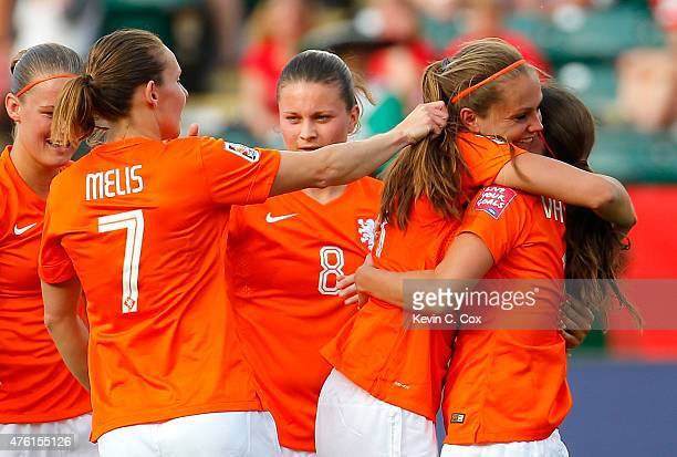 Lieke Martens of Netherlands hugs Danielle Van De Donk as she celebrates her goal against New Zealand with her teammates during the FIFA Women's...