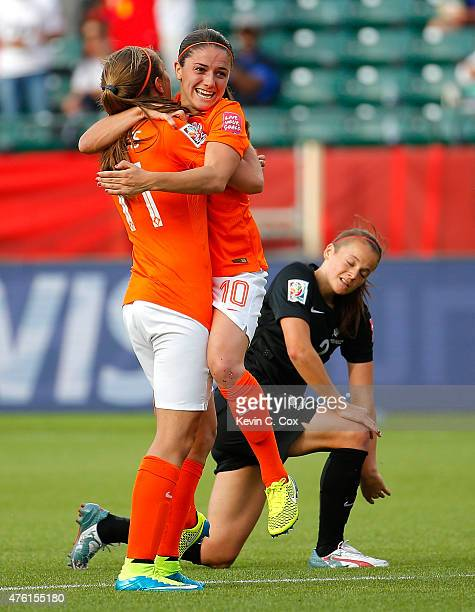Lieke Martens of Netherlands hugs Danielle Van De Donk as she celebrates her goal against New Zealand during the FIFA Women's World Cup Canada 2015...