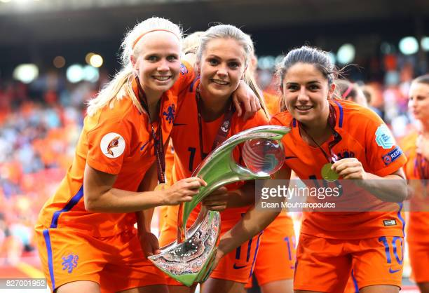 Lieke Martens of the Netherlands and Danielle van de Donk of the Netherlands celebrate with the trophy following the Final of the UEFA Women's Euro...