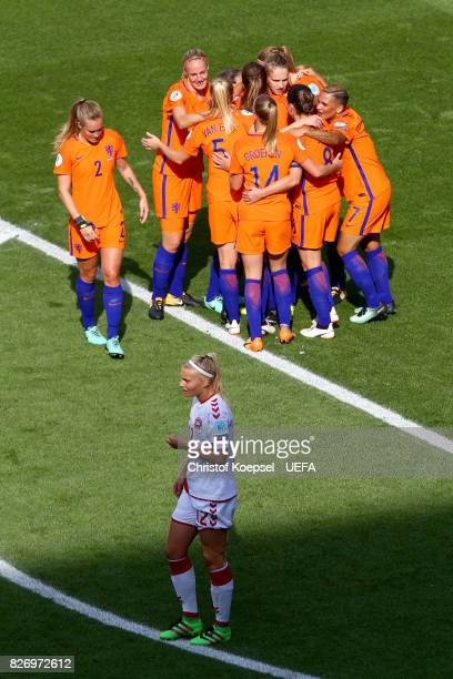 Lieke Martens of the Netherlands celerbrates the second ggoal and Stine Larsen of Denmark looks dejected during the UEFA Women's Euro 2017 Final...
