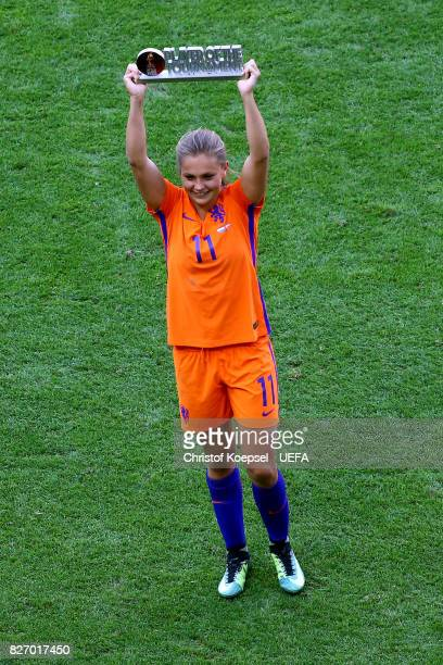 Lieke Martens of the Netherlands lifts the lifts the trophy on the podium after winning as the player of the tournament on the podium after winning...