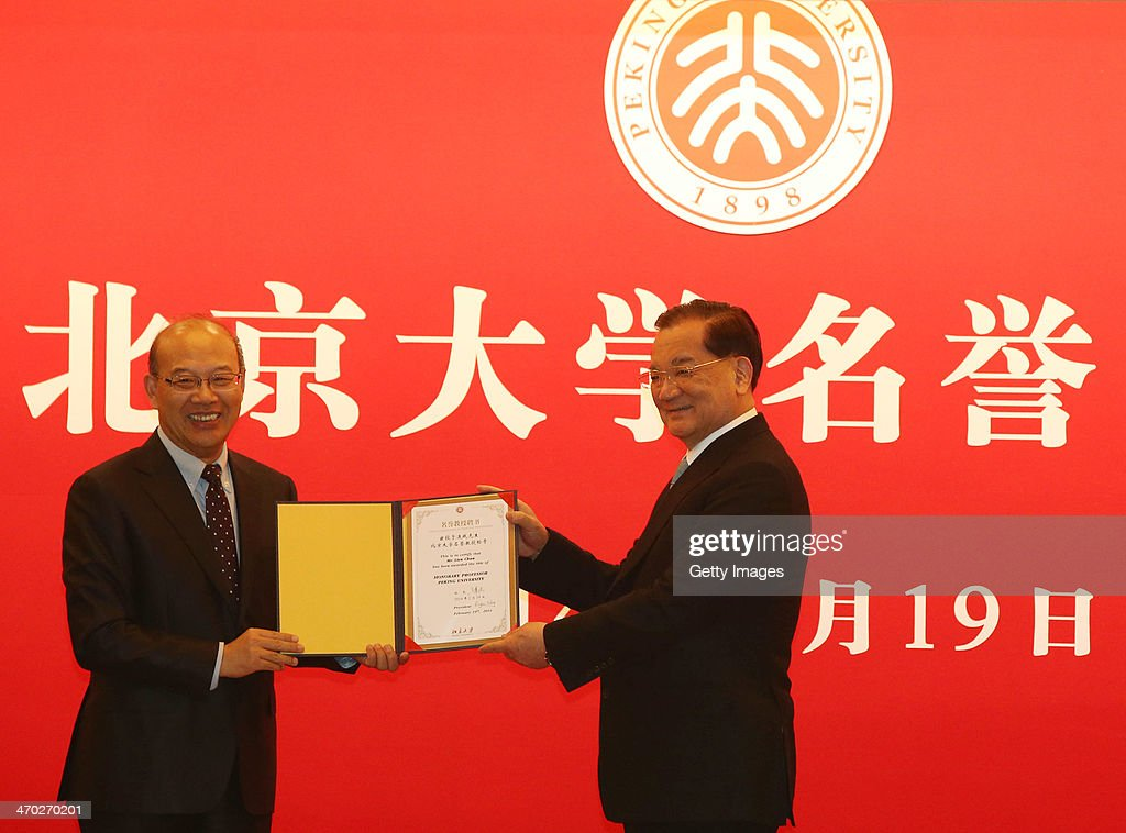 <a gi-track='captionPersonalityLinkClicked' href=/galleries/search?phrase=Lien+Chan&family=editorial&specificpeople=173452 ng-click='$event.stopPropagation()'>Lien Chan</a> (R), Kuomintang Honorary Chairman receives a 'honorary professor of Peking University' from Peking University President Wang Enge (L) on February 19, 2014, in Beijing, China. Lien, joined by business leaders and civil group representatives, paid a 4-day visit to Beijing from February 17 to 20. Xi Jinping, general secretary of the Communist Party of China Central Committee, met Lien on February 18. During the visit, Lien has visited sites related to the city's urban construction and countryside.