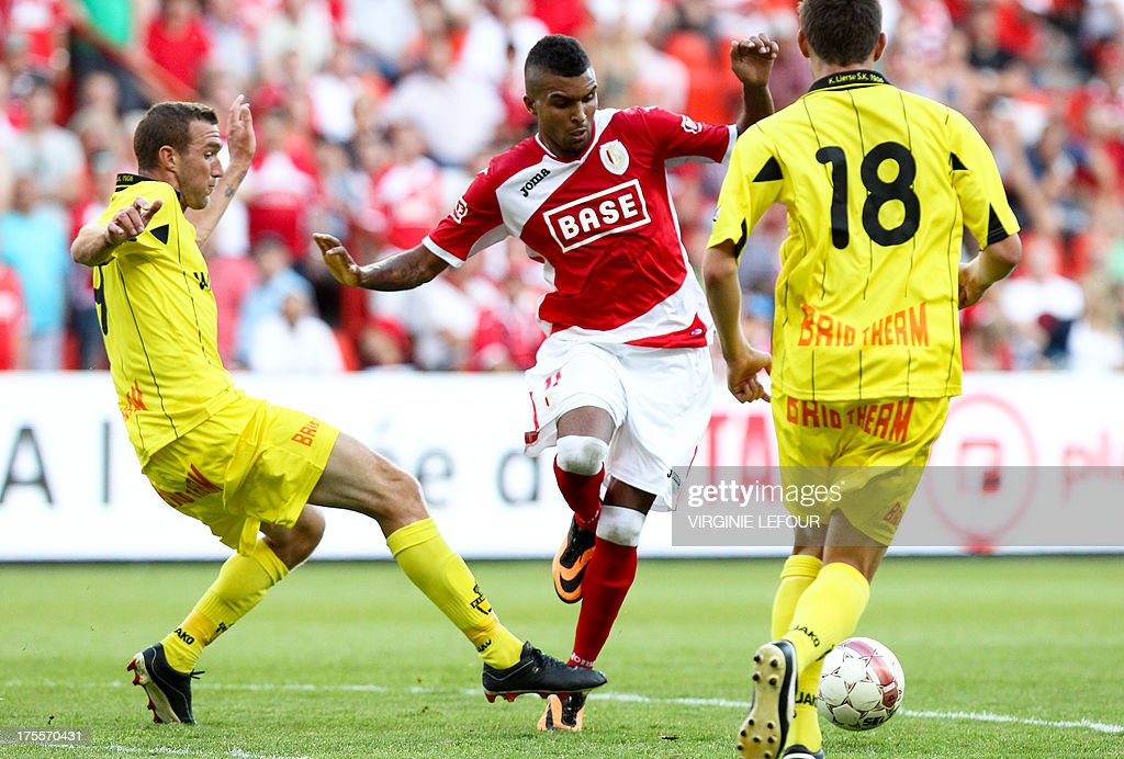 Lierse's Benjamin Lambot vies with Standard's Frederic Bulot (C) during the Jupiler Pro League match between Standard de Liege and Lierse SK, in Liege, on August 4, 2013 during the Belgian football championships.