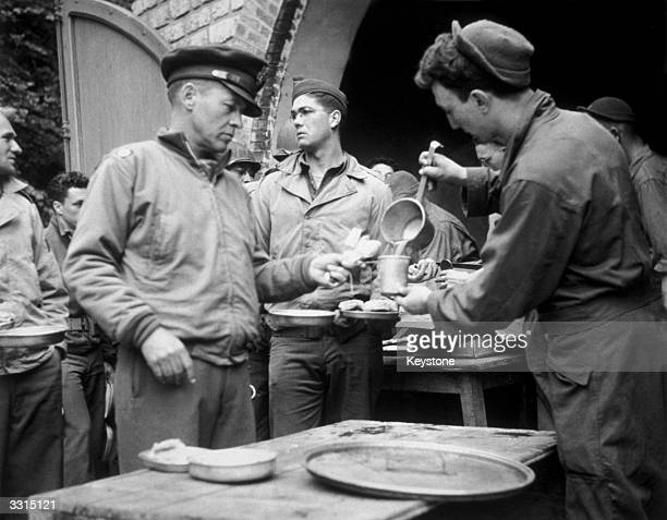 Lieutenant Colonel Bobby Jones the famous US golfer from Atlanta Georgia receives his rations in the field in Normandy