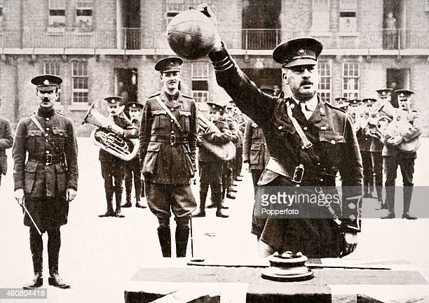 Lieutenant Colonel H P Treeby DSO holds aloft one of four footballs which led a charge of the 8th Battalion of the East Surrey Regiment across No...