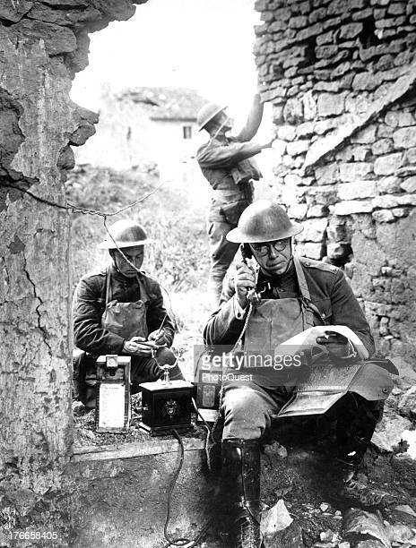 Lieutenant Colonel RD Garratt 42nd Division tests a telephone left behind by the Germans in their hasty retreat from the salient of St Mihiel Essey...