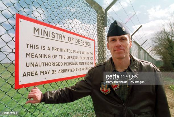 Lieutenant Commander who led the B52s bombing mission on Wednesday stands at the perimeter fence at RAF Fairford