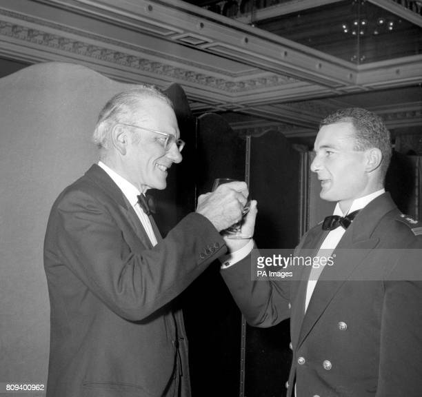 Lieutenant Eric Tabarly of the French Navy winner of the singlehanded transatlantic sailing racer exchanges a toast with the runnerup Francis...