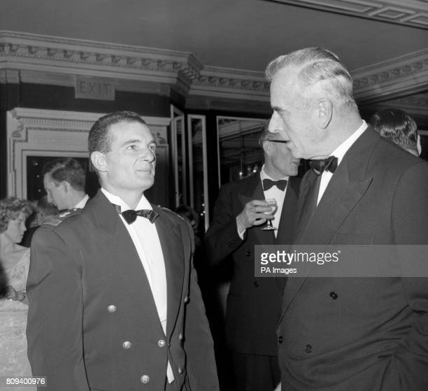 Lieutenant Eric Tabarly of the French Navy winner of the singlehanded transatlantic sailing racer tells Admiral of the Fleet Earl Mountbatten some of...