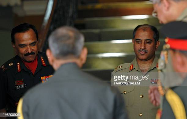 Lieutenant General A K Choudhary director general of Indian military operations walks with his Pakistani counterpart Major General Ishfaque Nadeem at...
