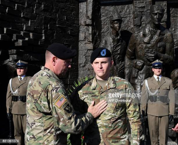 Lieutenant General Ben Hodges the US Army commander in Europe promotes Lieutenant Kirk Brandenburg to captain in front of the Warsaw Uprising...