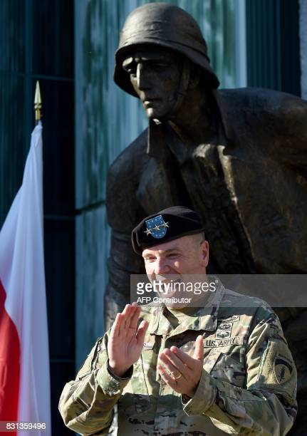 Lieutenant General Ben Hodges the US Army commander in Europe reacts after he promoted Lieutenant Kirk Brandenburg to captain in front of the Warsaw...
