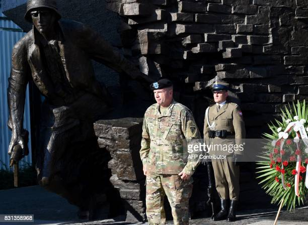 Lieutenant General Ben Hodges the US Army commander in Europe stands after laying a wreath at Warsaw Uprising Monument on August 14 2017 in the...