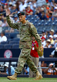 Lieutenant General Ken Tovo Commanding General of the United States Special Command waves as he heads for the mound o throw out the ceremonial first...