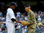 Lieutenant General Ken Tovo Commanding General of the United States Special Command is greeted by Michael Pineda of the New York Yankees before Tovo...