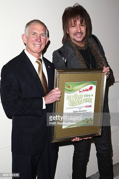 Lieutenant General Pete Osman presents the 'Stars Give Back' award to guitarist Richie Sambora during the 83rd Annual Hollywood Christmas Parade with...