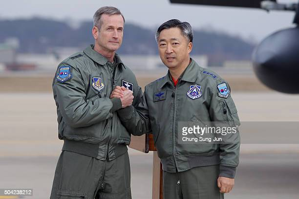 Lieutenant General Terrence J O'Shaughnessy deputy Commander of the US Forces Korea shakes hands with Lee WangGeun commander at South Korea's Air...
