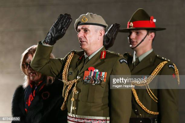 Lieutenant General Tim Keating salutes during Anzac Day dawn service at Pukeahu National War Memorial Park on April 25 2017 in Wellington New Zealand...