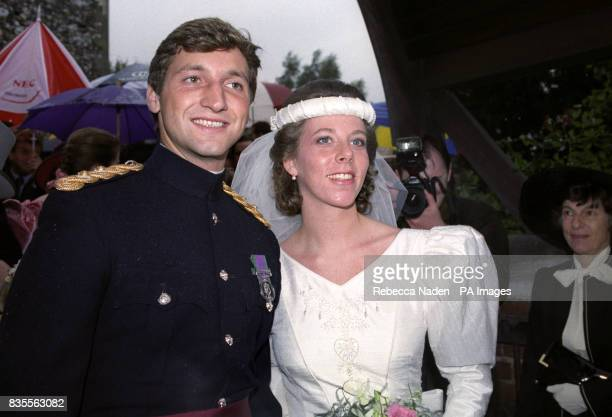 Lieutenant Natasha Collins halfsister of actress Joan Collins with her new husband Lieutenant Patrick Coxen after their wedding at St Peter and St...