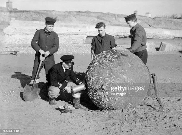 Lieutenant Noel Cashford at work on the German 'Vstar' antennae mine washed up at Cooden Beach Bexhill The officer had removed the detonator and was...